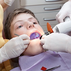 A younger patient receiving dental fillings.