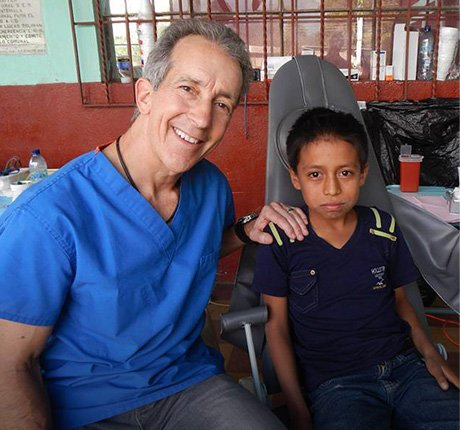 Dr. McKnight with patient on mission trip