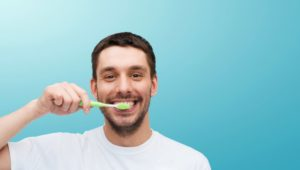 Smiling man practicing good dental habits