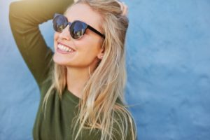 Smiling woman enjoys summertime thanks to teeth whitening in Mesquite