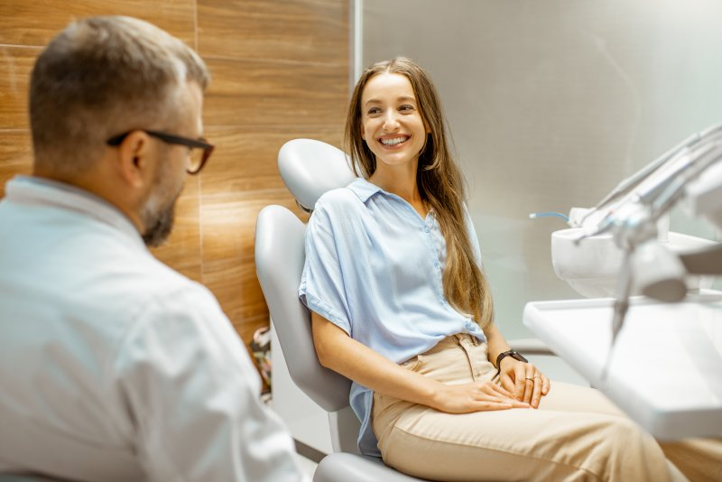 Patient talking to a cosmetic dentist